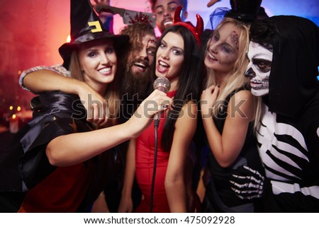 Group of friends singing at the party #475092928
