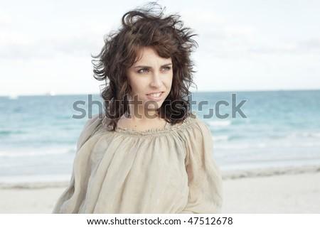Headshot of a beautiful woman on the beach #47512678