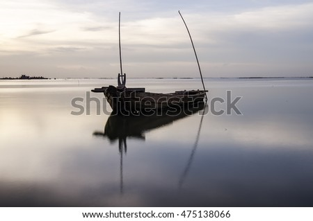 Twilight and sunset at the sea with fishing boat and cargo ship, soft focus  #475138066