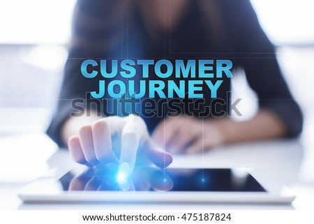"""Woman is using tablet pc, pressing on virtual screen and select """"Customer journey"""". #475187824"""