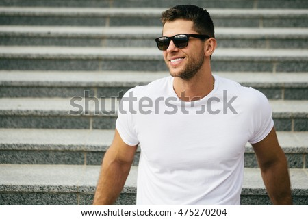 Hipster wearing white blank t-shirt with space for your logo #475270204