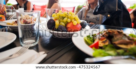 Grilled fresh-baked plates, cups, fruit.Food on the table #475324567