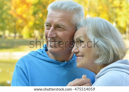 Senior couple in autumn park #475514059