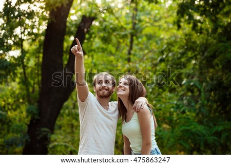 Young beautiful couple resting, walking in park, smiling, rejoicing. Outdoor background. #475863247