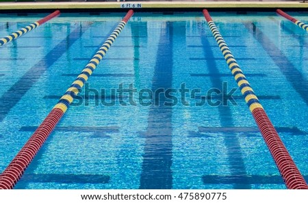 lanes in a competition swimming pool #475890775