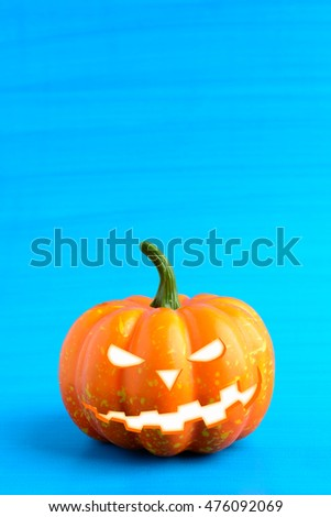 Three Halloween pumpkin with scary face on a blue background #476092069