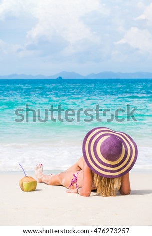 Cute woman relaxing on the tropical beach #476273257