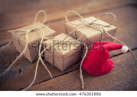 christmas gifts and santas hat on wooden board #476301886