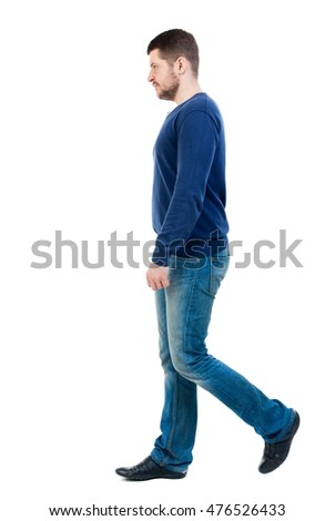 Back view of going handsome man. walking young guy . bearded man in blue pullover passes by the viewer. #476526433