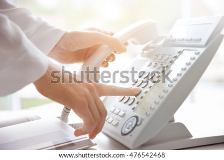 Businesswoman with office IP telephone #476542468