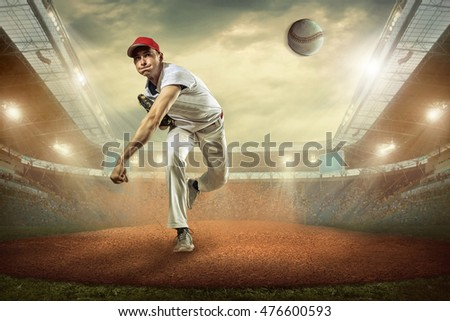 Baseball players in action on the stadium. #476600593