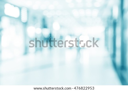 abstract defocused blurred background, empty business corridor or shopping mall. Medical and hospital corridor defocused background with modern laboratory (clinic) #476822953