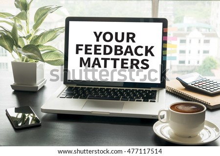 YOUR FEEDBACK MATTERS Computing Computer  Laptop with screen on table #477117514