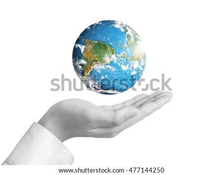 Human hand holding globe Elements of this image furnished by NASA #477144250