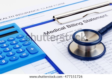 Medical bill and health insurance form with calculator Royalty-Free Stock Photo #477151726