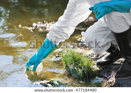 Woman with flask for expertise. Environmental pollution concept Royalty-Free Stock Photo #477184480