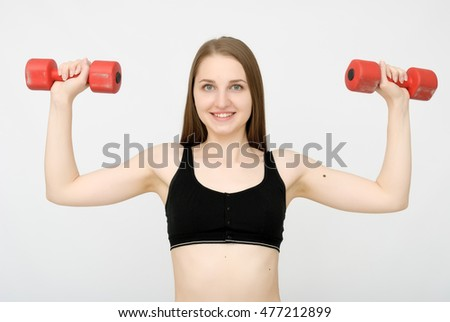 attractive fitness woman with dumbbell doing exercise  #477212899