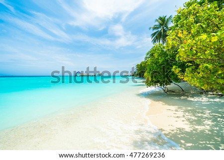 Beautiful tropical Maldives resort hotel and island with beach and sea on sky for holiday vacation background concept - Boost up color Processing #477269236