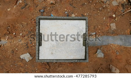 concrete manhole on ground and stone background #477285793