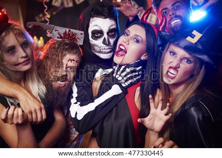 Spooky costumes of party people #477330445