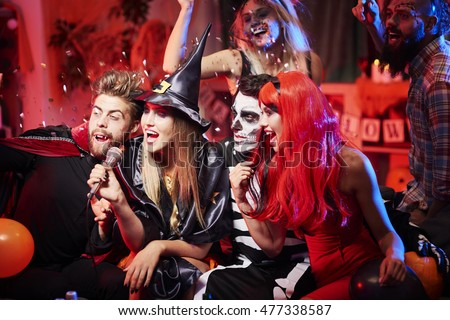 Karaoke show at halloween party #477338587