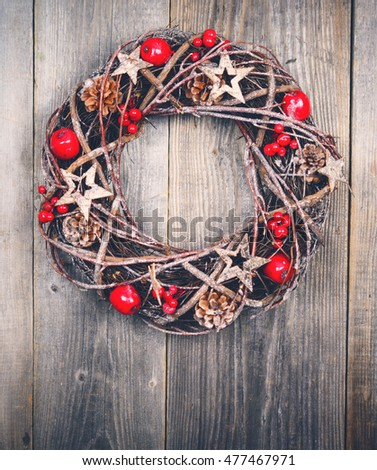 Christmas wreath on wooden background - Top view #477467971