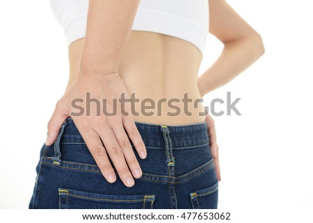 Woman who has a back pain #477653062