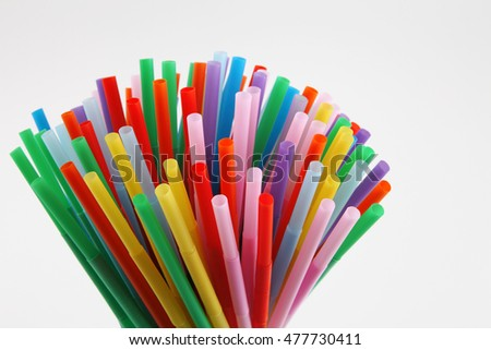 colorful plastic straw on the white background #477730411