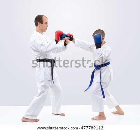 Blows hands athlete is beating on the overlays trainer #477789112