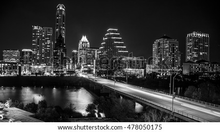 Austin Texas skyline cityscape at night black and white long exposure traffic over congress bridge