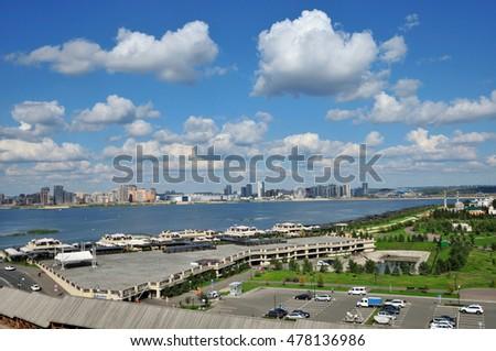Kazan, Tatarstan, Russia - September 4, 2016.A view of the Kremlin embankment of the river Kazanka. Right and left bank of the Kazanka River. New Savinovskij district. #478136986