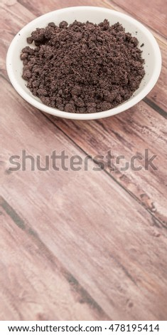 Super food dried maqui berry powder in white bowl over wooden background #478195414