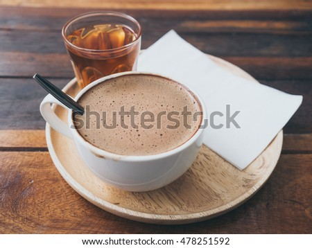 White coffee cup on wooden table. #478251592