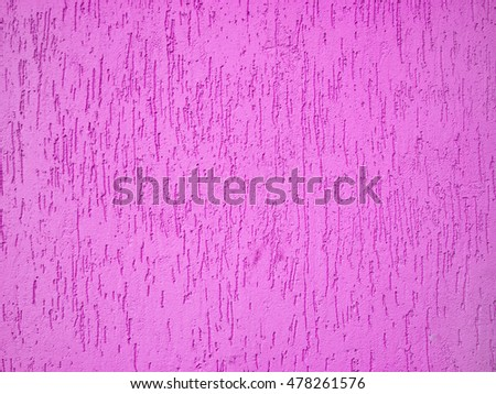 Painted pink color wall fragment as a texture background #478261576