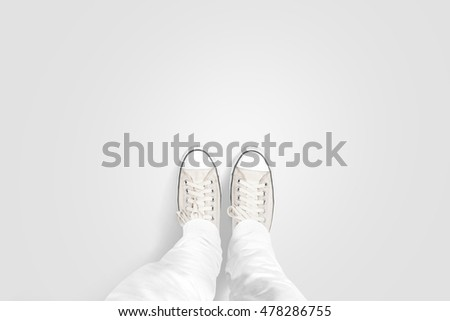 Person taking photo of his foots stand on blank floor, isolated, top view, clipping path. Ground design mock up. Man wear gumshoes and watching down. Deck flooring mockup template. #478286755