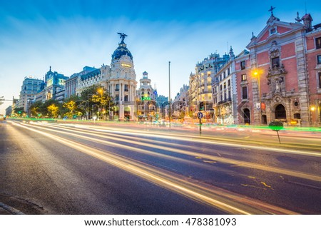 Madrid, Spain - September 2016: Downtown Madrid, Spain, where the Calle de Alcala meets the Gran Via. These are some of the most famous and busy streets in Madrid. #478381093