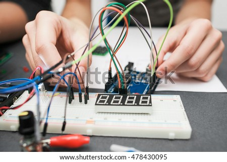 Breadboard with cables close-up. Electronic construction development. Modern technologies, electronics, diy product engineering #478430095