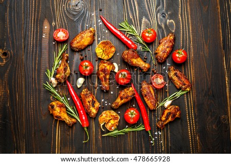 roasted chicken wings with herbs #478665928