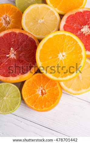 Cut citrus fruits on a background of white boards. #478701442