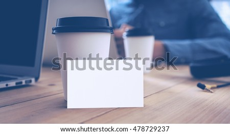 White Business Card Mockup Wood Table Take Away Coffee Cup.Adult Businessman Work Modern Notebook Office Blurred Background.Clean Empty Object Ready Private Corporate Information.Horizontal Mock Up