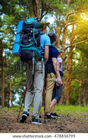 Adventure and hiking. Group of young people make a hike in mountains. Active lifestyle. Tourist equipment. #478836799