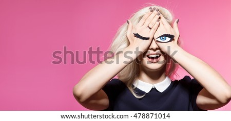 Woman with closed and open eyes painted on hands