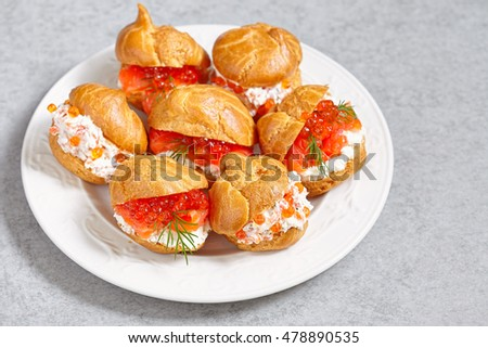 Profiteroles with salmon, red caviar and cheese cream #478890535