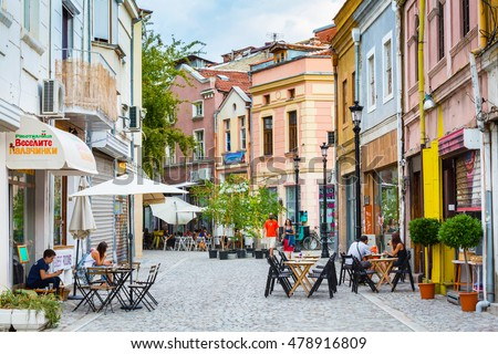 Plovdiv, Bulgaria - September 3, 2016: City center street with houses, cafe and people #478916809