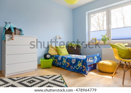 Pastel child room with a chest of drawer, bed, pouf and big window #478964779