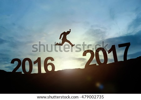 Silhouette of businessman glowing jump 2016 to 2017. success concept #479002735