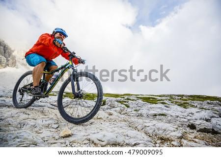 Mountain biking in the Dolomites, Tre Cime di Lavaredo, Italy.  #479009095