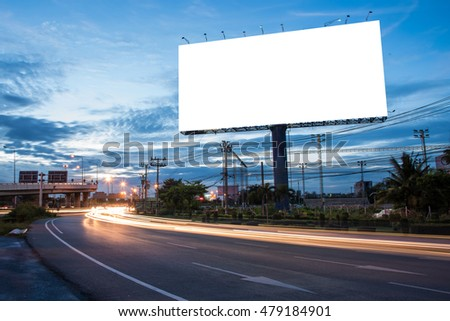 Blank billboard for advertisement at twilight time with light trails on the road at dusk, business advertising concept. #479184901