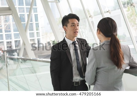 Asian business man and woman talk to each other #479205166