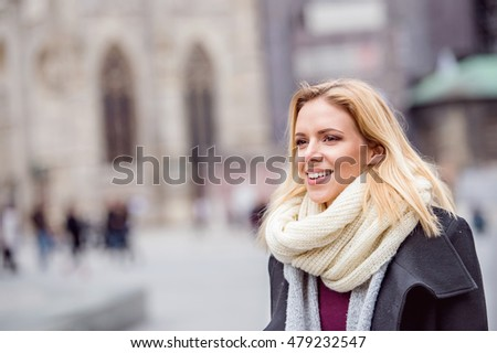 Woman on a walk in centre of the city. Winter #479232547